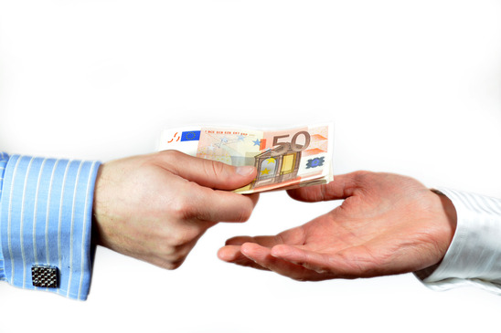 Male hand paying 50 euros to someone else, isolated on white
